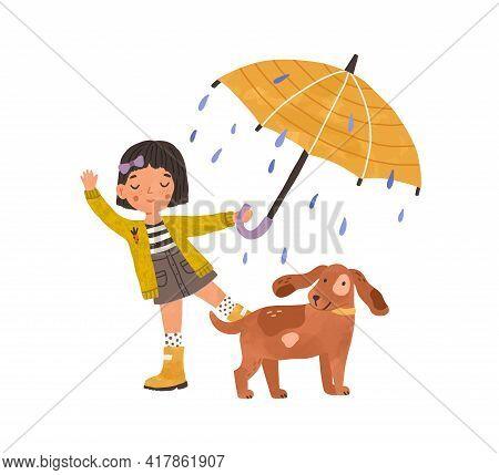 Happy Girl Walking With Cute Dog Under Umbrella, Enjoying Rain. Kid In Gumboots Playing Or Dancing O