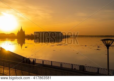Cityscape. River And Sunset. The City Of Nizhny Novgorod At Sunset At The Confluence Of The Two Rive