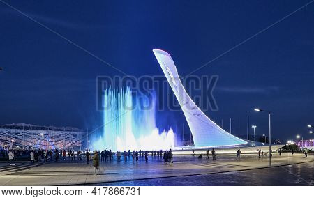 Sochi, Russia - March 3, 2020: Evening Show Of Singing Fountains In The Olympic Park Sochi. Sculptur