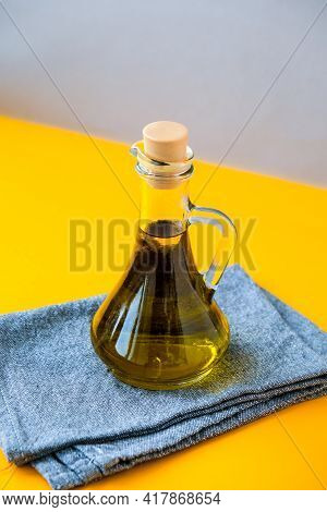 Fresh And Delicious Olive Oil On Kitchen Towel. Ingredients For Food Cooking. Healthy Eating. Keto D