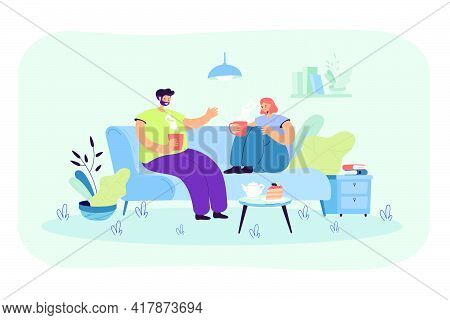 Young Couple Spending Romantic Evening Together In Their Apartment. Man And Woman Sitting On Sofa In