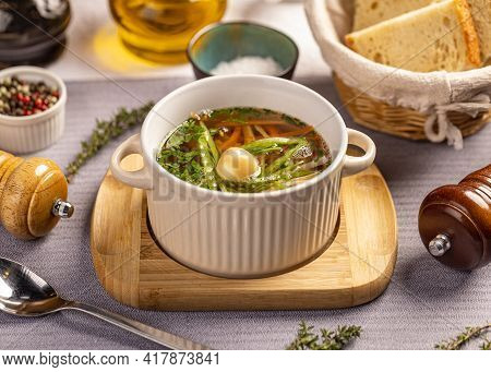 Classic Chicken Vegetable Soup Served With Smoked Quail Egg