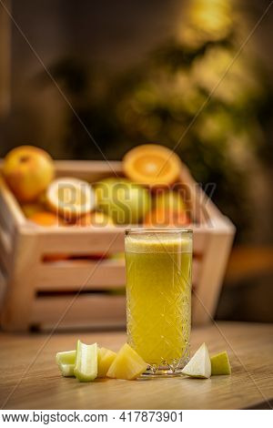 Healthy Rhubarb, Pineapple And Apple Juice On Wooden Table, Blurred Background