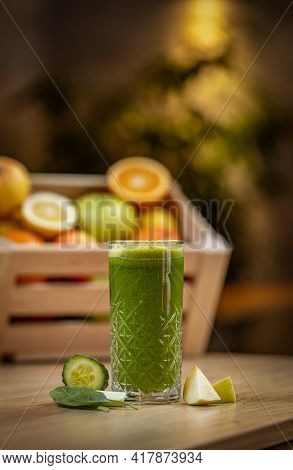 Healthy Cucumber, Spinach And Apple Juice On Wooden Table, Blurred Background