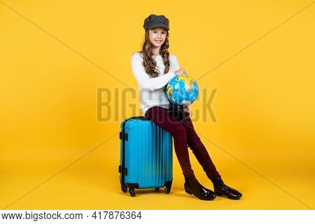 Just Relax. Stylish Kid Ready For Trip. Wanderlust. Teenage Girl With Globe. Happy Childhood