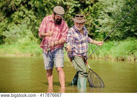 Who Has More. Father And Son Fishing. Hobby And Sport Activity. Trout Bait. Two Happy Fisherman With