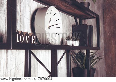Shabby Chic Interior Decor. White Round Clock And Wooden Letters On A Vintage Shelf. Word Love Made