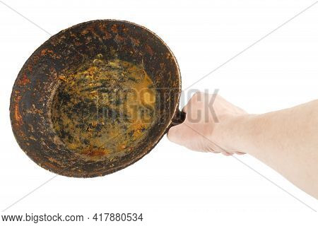 Bare Caucasian Hand Holding Empty Old Cast Iron Frying Pan