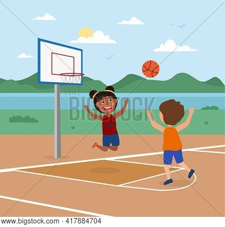 Cute Little Kids Are Playing Basketball On A Court Outdoors Together. Smiling Children Enjoing The B