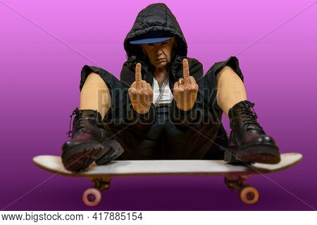 Funny Portrait Of Mature Woman. Lady Having Fun With Skate Dressed As Rapper. Mature Woman On Colore