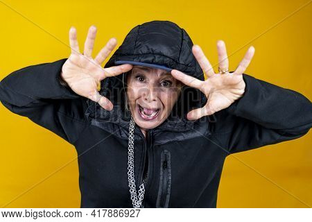 Funny Portrait Of Mature Woman. Lady Having Fun Dressed As An Angry Rapper