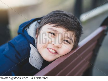 Close Up Head Shot Kid Looking At Camera With Smiling Face, Healhty Child With Happy Face With Blurr