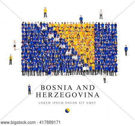 A Large Group Of People Are Standing In White, Blue And Yellow Robes, Symbolizing The Flag Of Bosnia