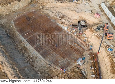 Aerial View Of A Onstruction Site With Foundation Pit For Monolithic Reinforced Skyscraper. Monolith