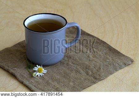 Cup Of Tea.grey Mug Of Chamomile Tea On Sackcloth. Blue Cup Of Hot Herbal Chamomile Tea On A Wooden