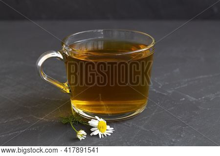 Hot Drinks. Mug Of Chamomile Tea. Glass Cup Of Iced Herbal Chamomile Tea On A Black Table With Copy
