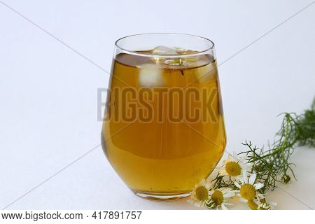 Chamomile Tea. Glass Cup Of Iced Herbal Chamomile Tea On A White Table With Copy Space. Cup Of Tea W