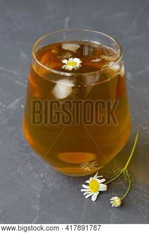 Cup Of Tea With Chamomile.glass Cup Of Iced Herbal Chamomile Tea On A Grey Table With Copy Space. Cu