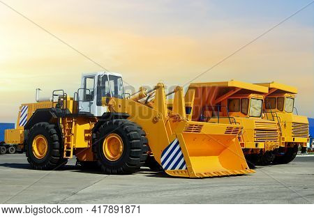 Wheel Loader And Mining Truck. Heavy Construction Machinery And Mining Equipment. Front-end Loader O