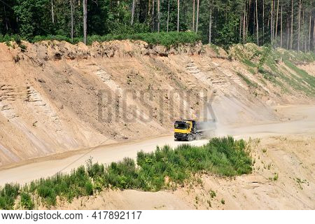 Dump Truck Transports Sand In Open Pit Mine. In The Production Of Concrete, Concrete For The Constru