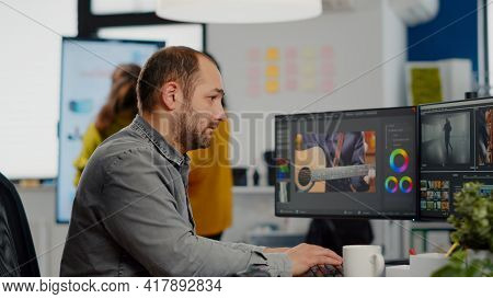 Man Video Editor Looking At Camera, Working With Footage