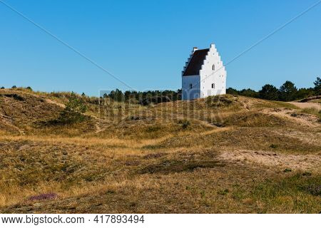 The Sand-Covered Church or Buried Church - Den Tilsandede Kirke in Danish  - Sct Laurentii from 14th century near the city of Skagen  in Denmark