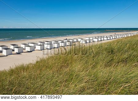 The beach of Løkken, Denmark, with it's characteristic white wooden beach huts