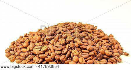 Fragrant Roasted Coffee Beans Isolated On White Background. Copy Space Text. Selective Focus.