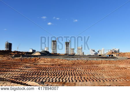 View Of A Large Construction Site. Construction Of A New Road In A New Residential Area. Excavation