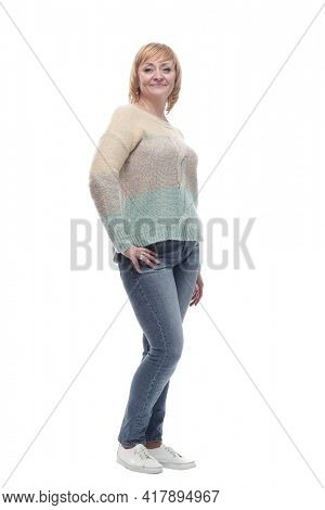 casual smiling woman in jeans and a white jumper.