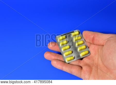 Pills And Capsules In Hands. Medicine Grade Pharmaceutical Tablets In Packpage. Medical Pill For Mai