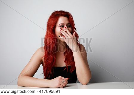 Headshot Of Playful Shy Woman Hiding Face Laughing Timid. Caucasian Woman Smiling Happy Through Hand