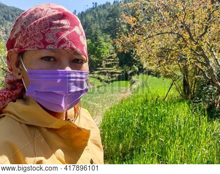 Closeup Shot Of An Indian Young Woman Which Wearing Dhatu (himachal Fashion Accessory) And Face Mask
