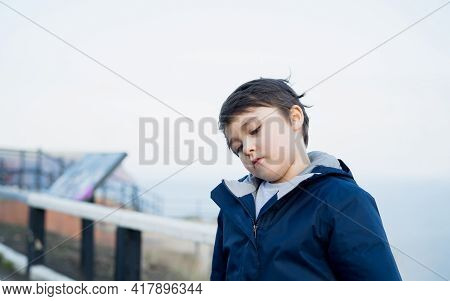 Dramatic Portrait Lonely Kid Sad Or Bored Face, Upset Young Boy Standing Alones Outside, Child Looki