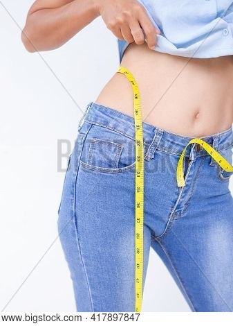 Waist Tape With Woman. Slim Fit Lady Measuring Her Waist On White Background. For Weight Loss, Diet