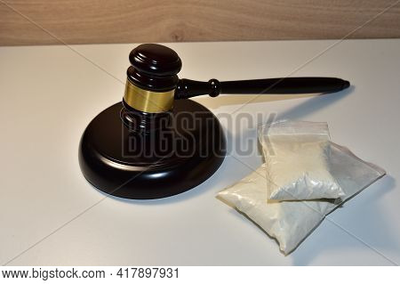 Cocaine And Judge Hammer In Courtroom. Legal Excuse And Justice Concept. Sentence To A Criminal For