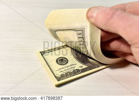 A Bundle Of One Hundred Dollar Bills During Counting. Money Account Concept. Man's Hand Counts Dolla
