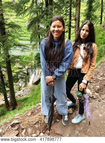 Full Length Shot Of Beautiful South Asian Young Girls Posing With Looking At Camera While Hiking, Ou