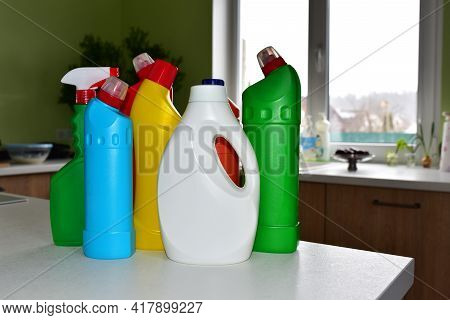 Detergent Bottles At Kitchen In Home. Detergents And Laundry Concept. Household Chemicals For Cleani