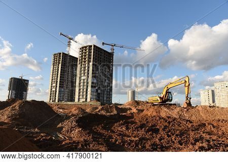 Excavator Dig The Trenches At A Construction Site. Trench For Laying External Sewer Pipes. Sewage Dr