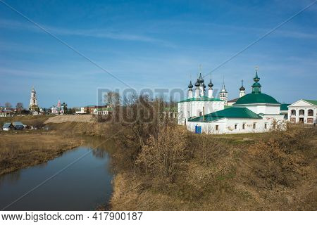 Friday church and Log-Jerusalem church on the bank of the river Kamenka in Suzdal in spring middle april, Russian heritage architecture, Golden Ring of Russia