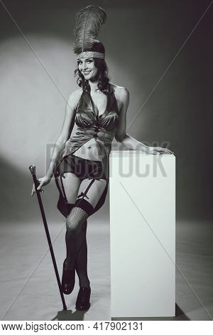 Pretty Woman In Performer Burlesque Costume Suit With Cane Studio