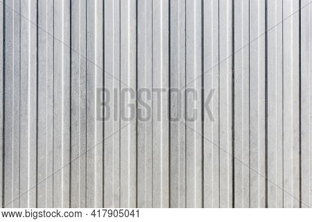 Corrugated Metal Sheet Background. Grunge Old Grainy Metal Texture. Silver Color Industrial Pattern.