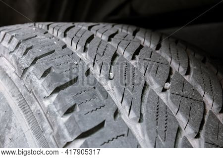 Small Stone Embedded In The Treads Of Tire. Should Be Removed Because It May Cause The Tire To Be Da