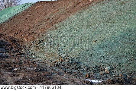 Stabilization Of Slopes By Hydro Sowing. A Mixture Of Wood Pulp And Green Grass Seed Is Sprayed From