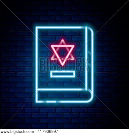 Glowing Neon Line Jewish Torah Book Icon Isolated On Brick Wall Background. On The Cover Of The Bibl