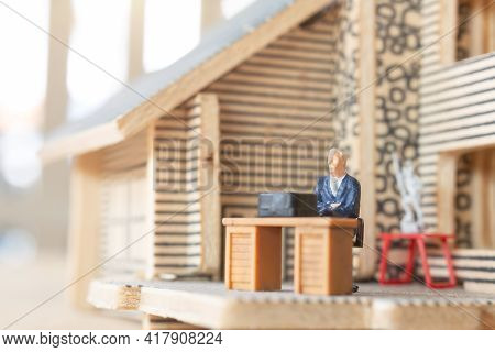 Miniature Business People Working At Home To Protect Himself From Corona Virus
