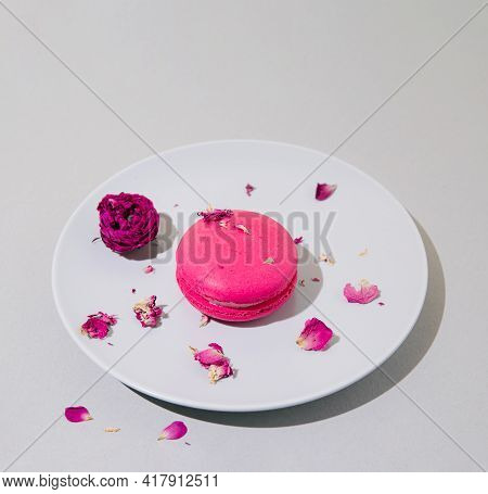 Rose Flavour Macaroon On A Plate On Grey Pastel Background.