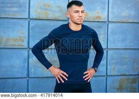 Outdoor Candid Portrait Of An Athletic Man Taking A Break After Workout In The City Street. Athlete