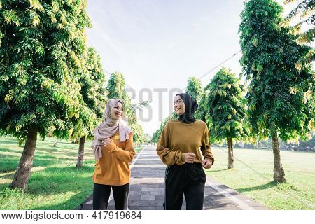 Two Muslim Teenage Girls In Veil Doing Outdoor Sports Together Just Before Breaking The Fast
